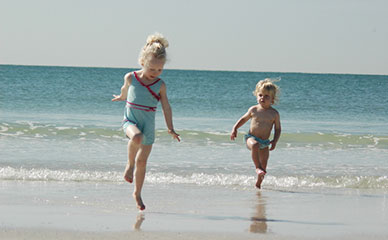 Wade in the surf and play in the sand, enjoy a family vacation on Anna Maria Island, FL.